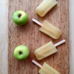 Apple popsicles on board with applies