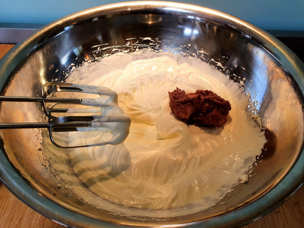 Adding first blob Nutella cream cheese mix to cream
