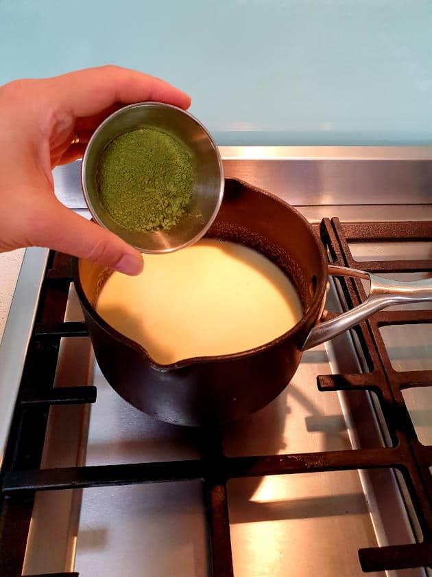 Adding matcha powder to pot