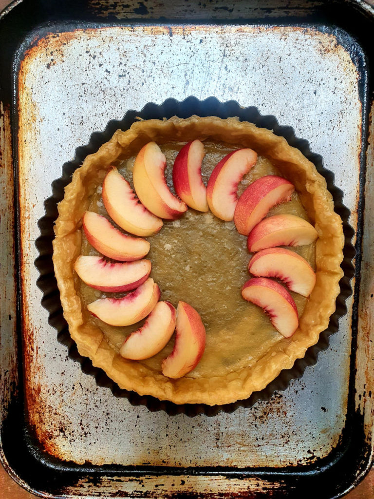 Adding nectarine slices to tart shell