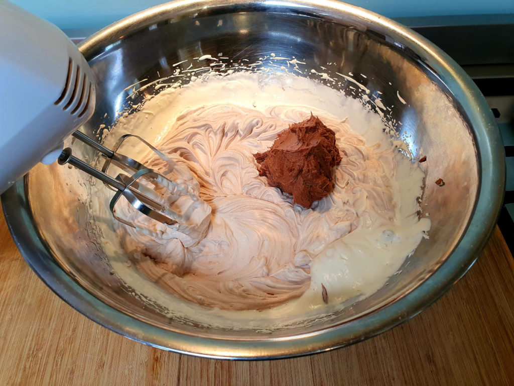 Adding second blob Nutella cream cheese mix to cream