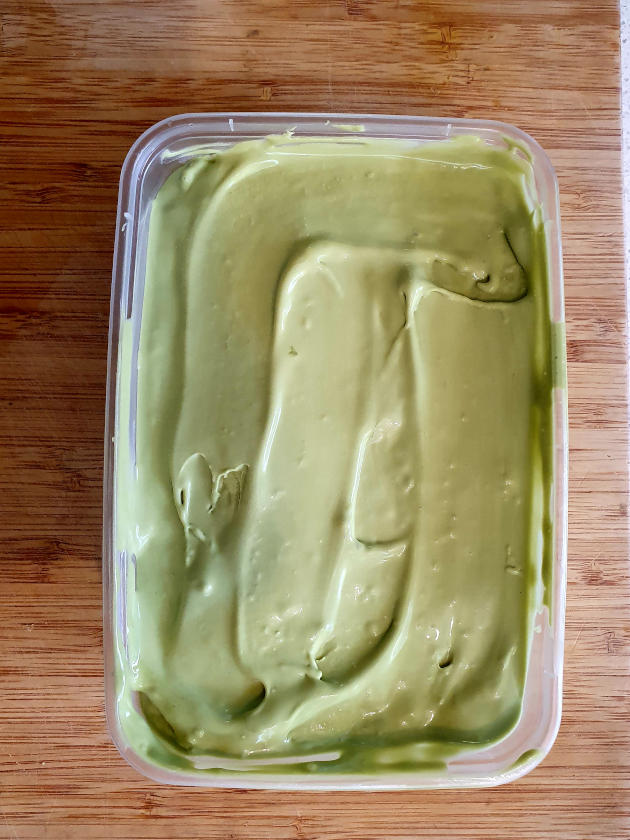 Churned matcha ice cream in container
