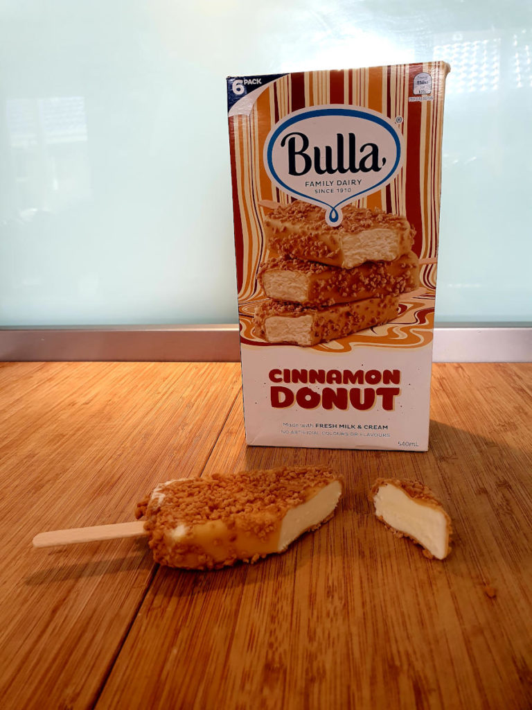 Cut open bulla cinnamon donut ice cream and box