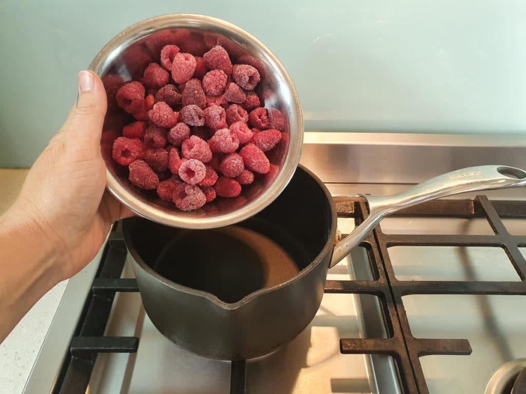 Adding raspberries to pot