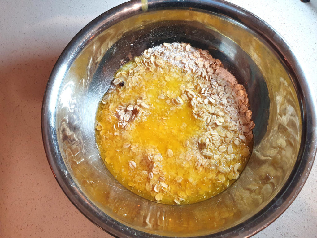 Adding melted butter to crumble topping mix