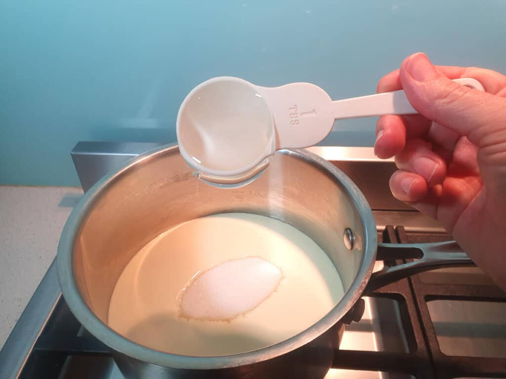 Adding glucose syrup to pot