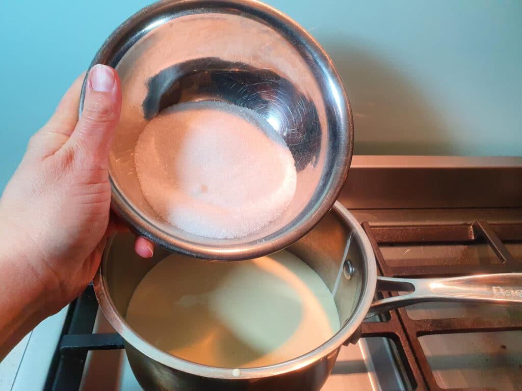 adding sugar to pot