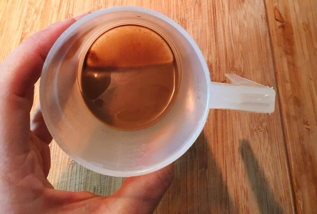 coffee sludge in bottom of cup
