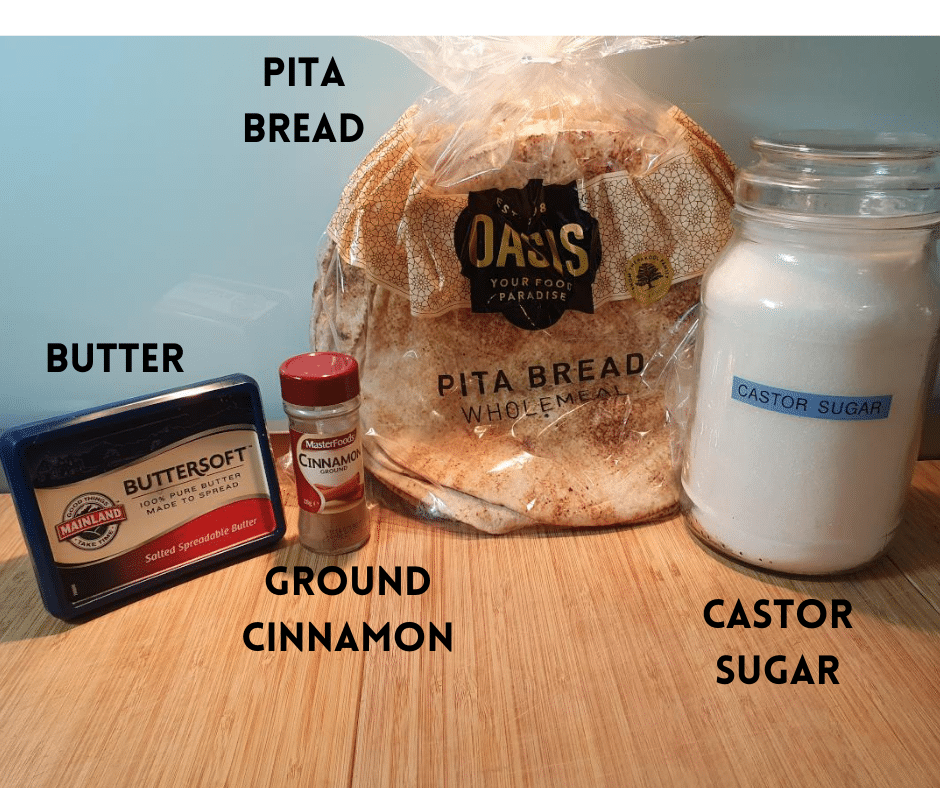 Pita chips ingredients on a chopping board, butter, ground cinnamon, pita bread and castor sugar, side view.