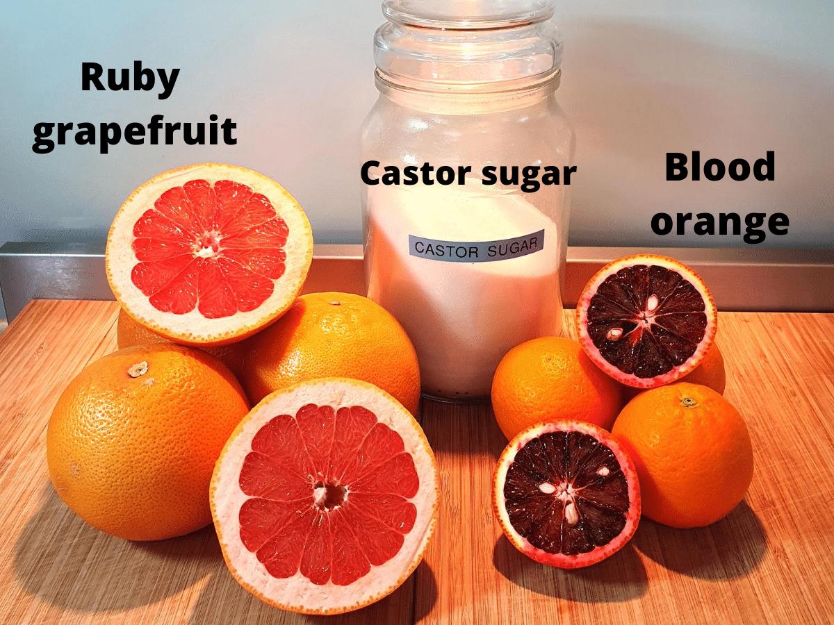 ingredients for popsicles, ruby grapefruit, castor sugar and blood oranges