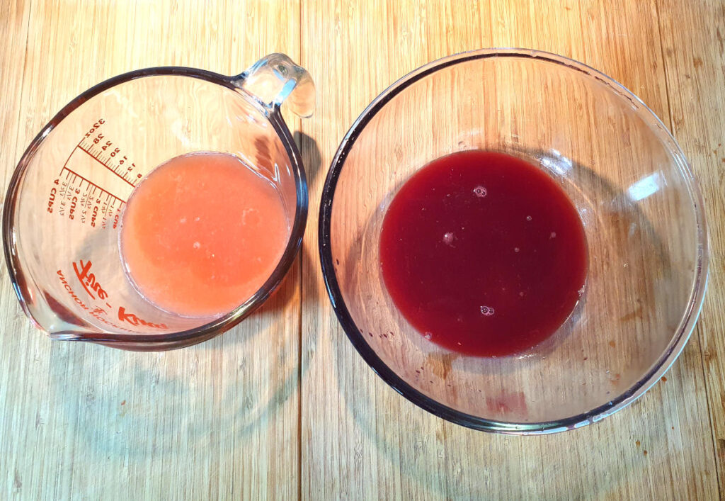 grapefruit and orange juice in containers side by side showing colour difference