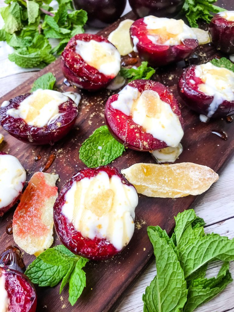 Grilled plums with honey ginger yoghurt