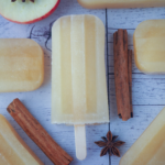 Top down view of mulled apple cider popsicle, with apple, apple star and star anise.