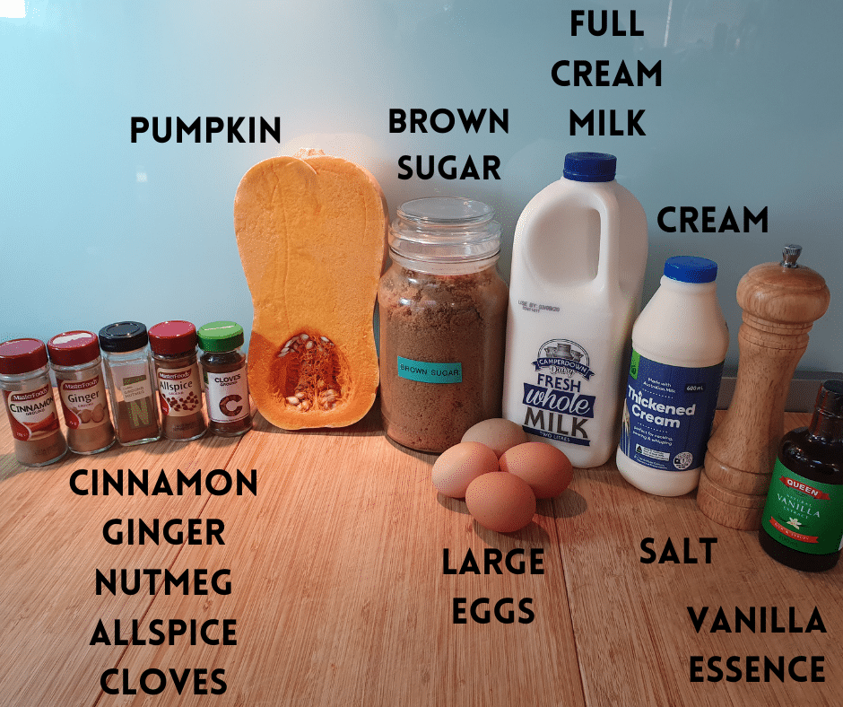 Pumpkin spice ice cream ingredients on a chopping board, ground spices, cinnamon, ginger, nutmeg, allspice, cloves, pumpkin, brown sugar, full cream milk, large eggs, cream, salt, vanilla essence.