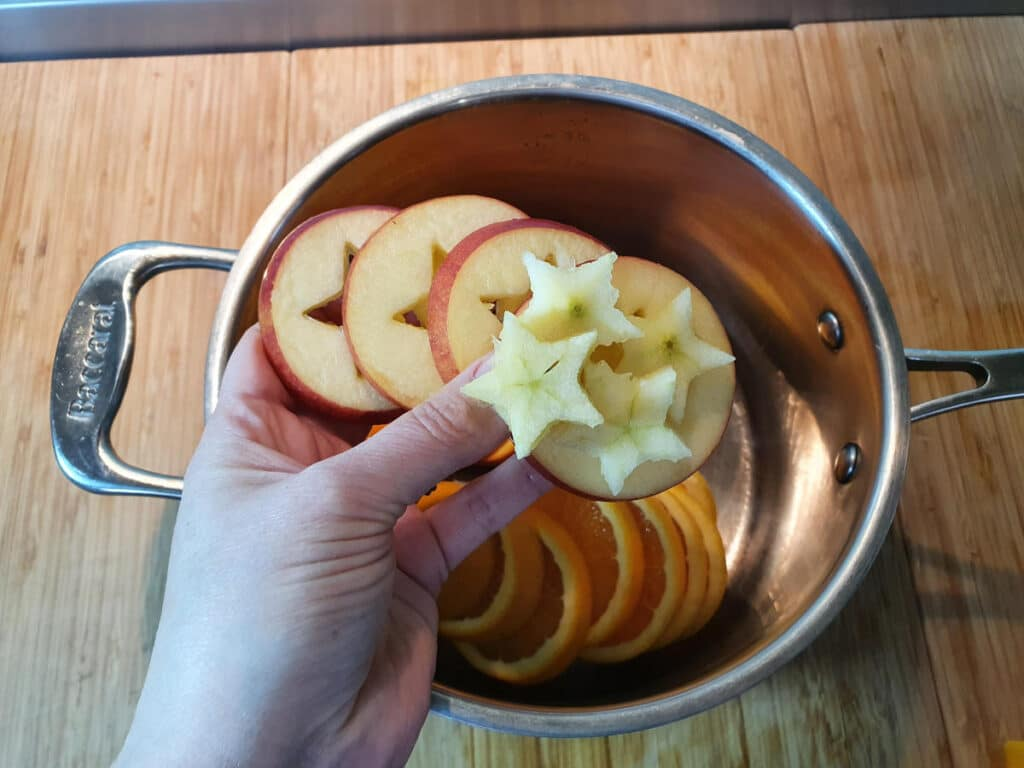adding apple slices and start to pot.