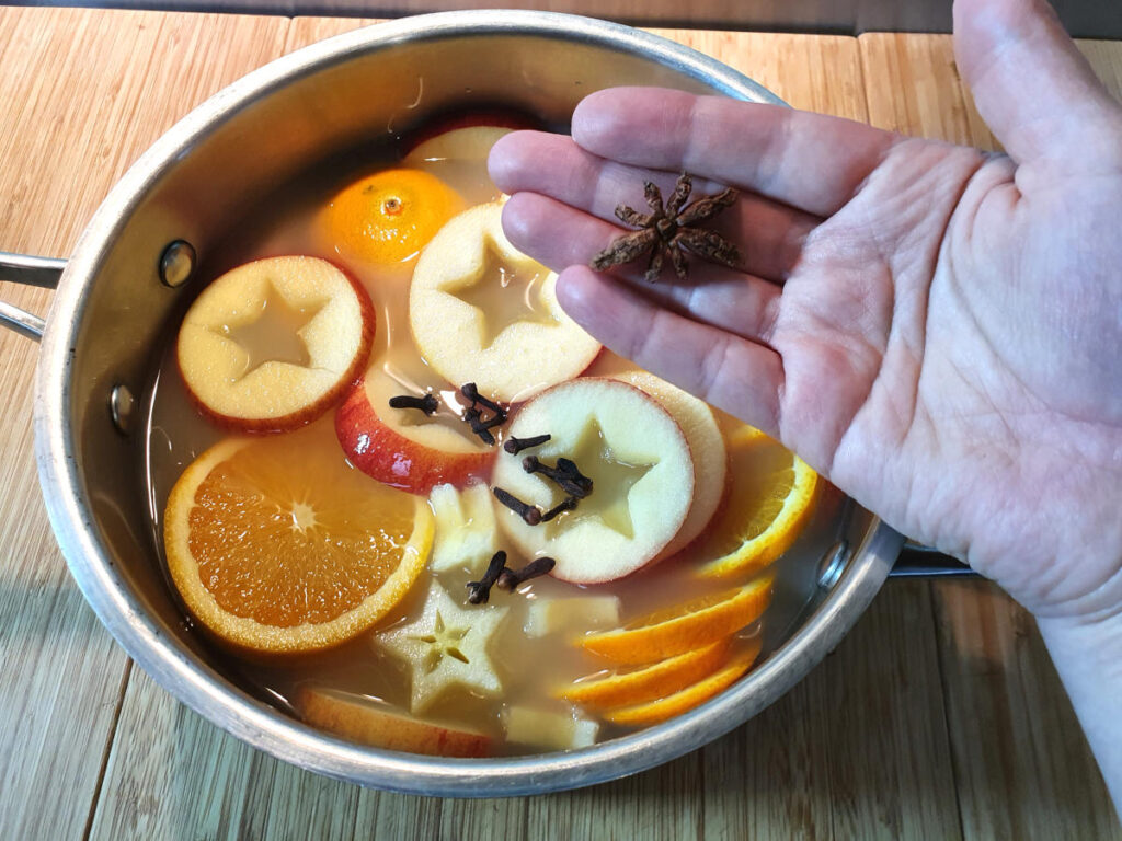 Adding star anise to pot.