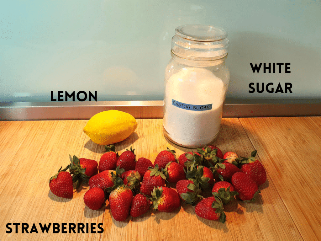 strawberry sauce ingredients, lemon, strawberries and white sugar.