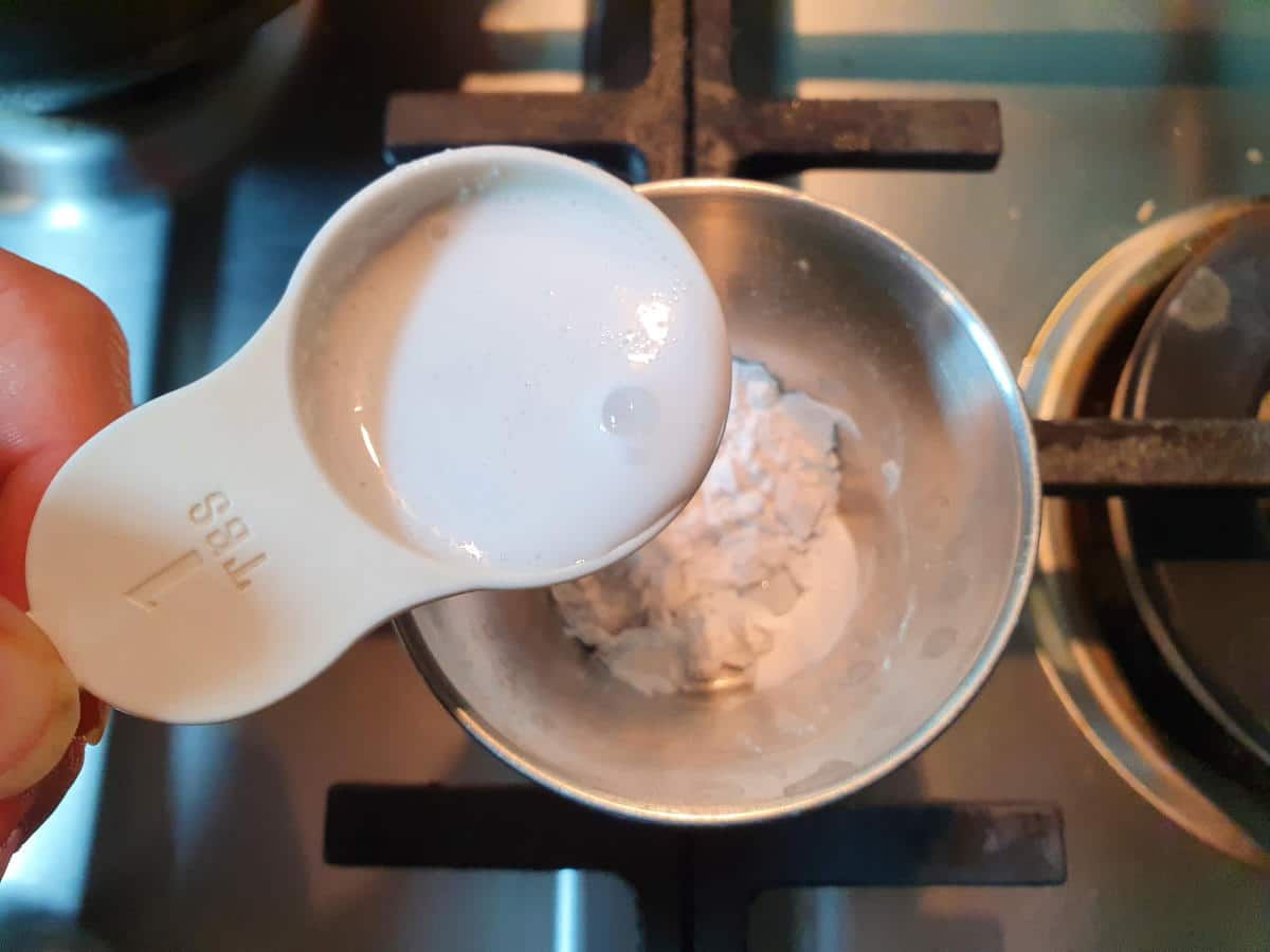 adding milk to tapioca starch.