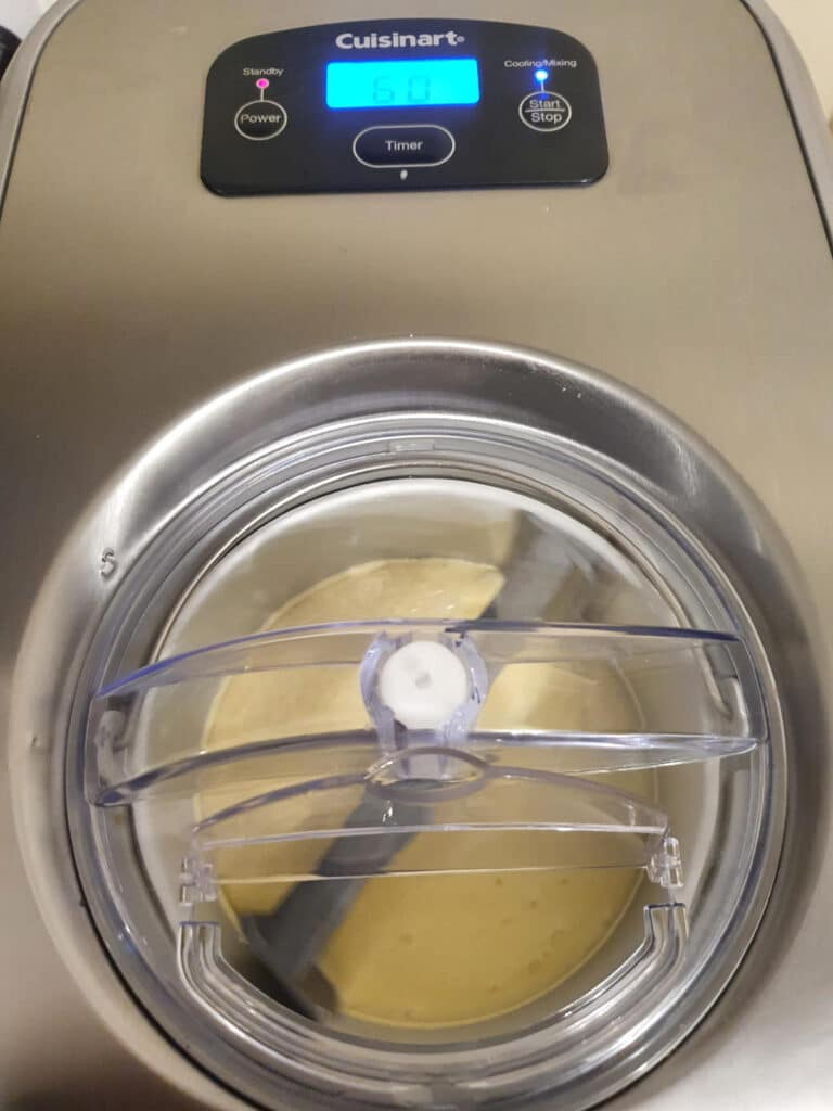 churning ice cream in ice cream machine.