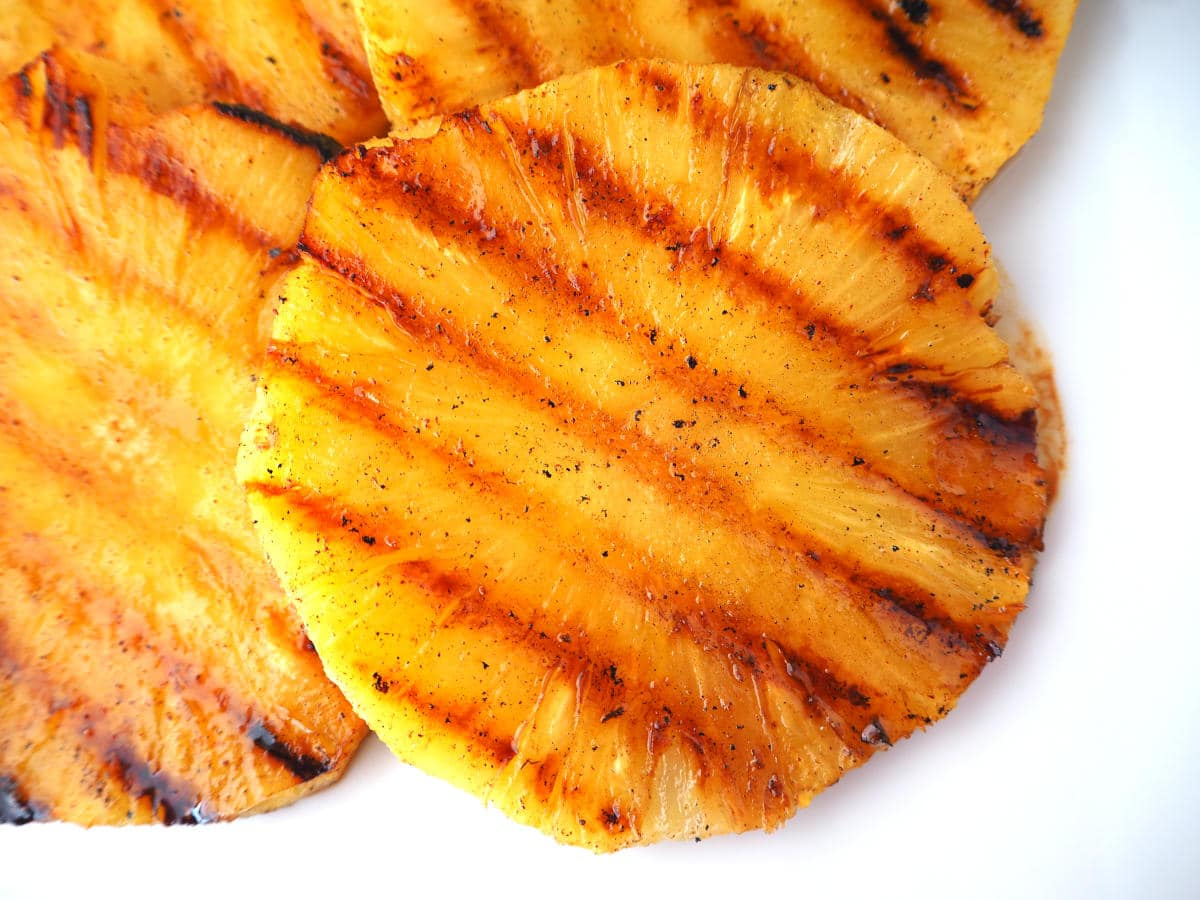 Top down view of grilled pineapple showing griddle lines.
