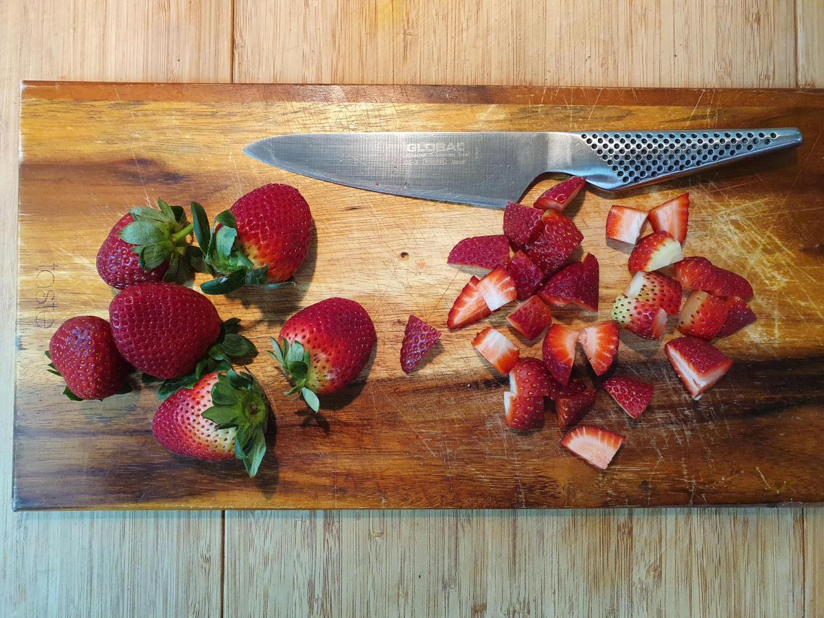 slicing up strawberries.