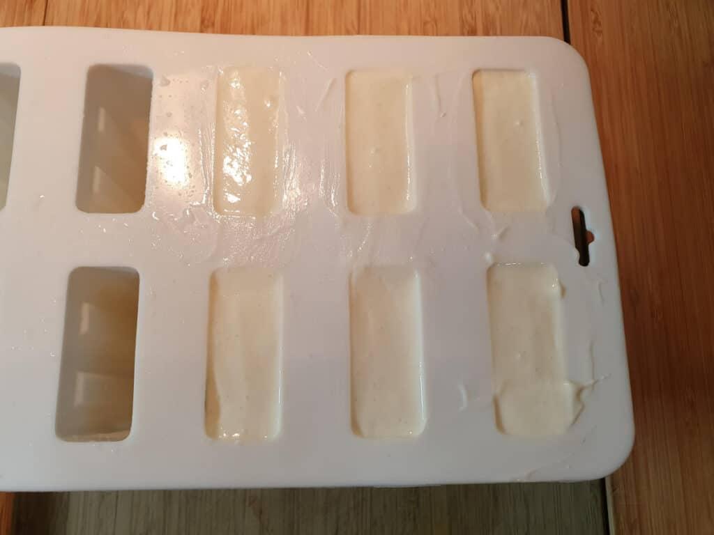 final layer of vanilla yogurt in popsicle molds.