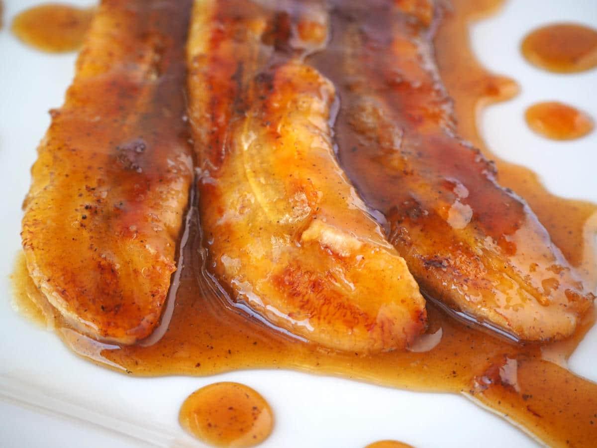 Close up caramelized bananas in caramel sauce.