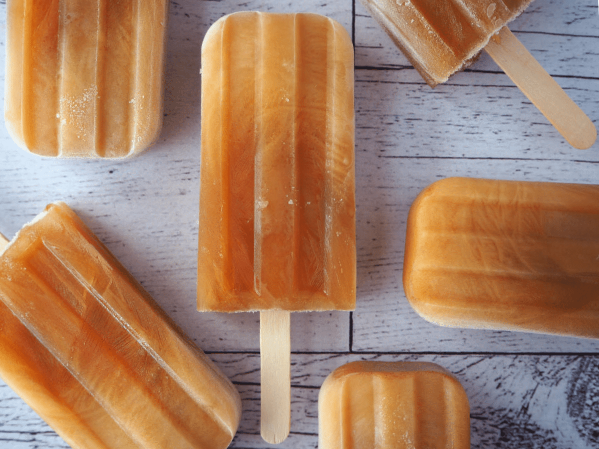 Top down view of group of cola popsicles.