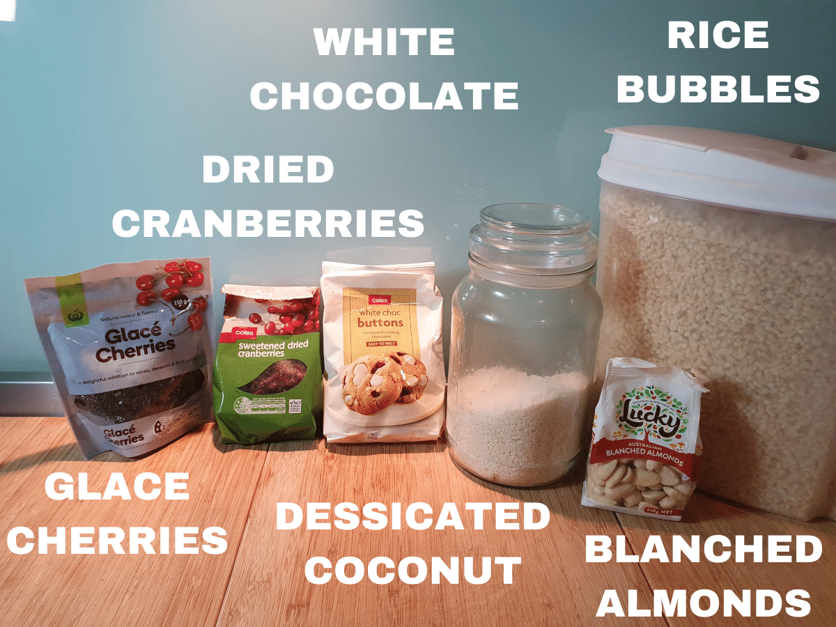 White Christmas ingredients, glace cherries, dried cranberried, white chocolate melts, dessicated coconut, blanched almonds, rice bubbles.
