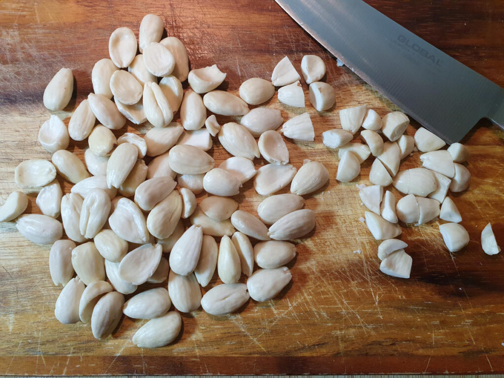 chopping blanched almonds with a sharp knife.