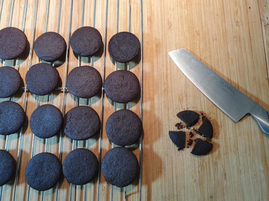 chopping up homemade Oreos into quarters.