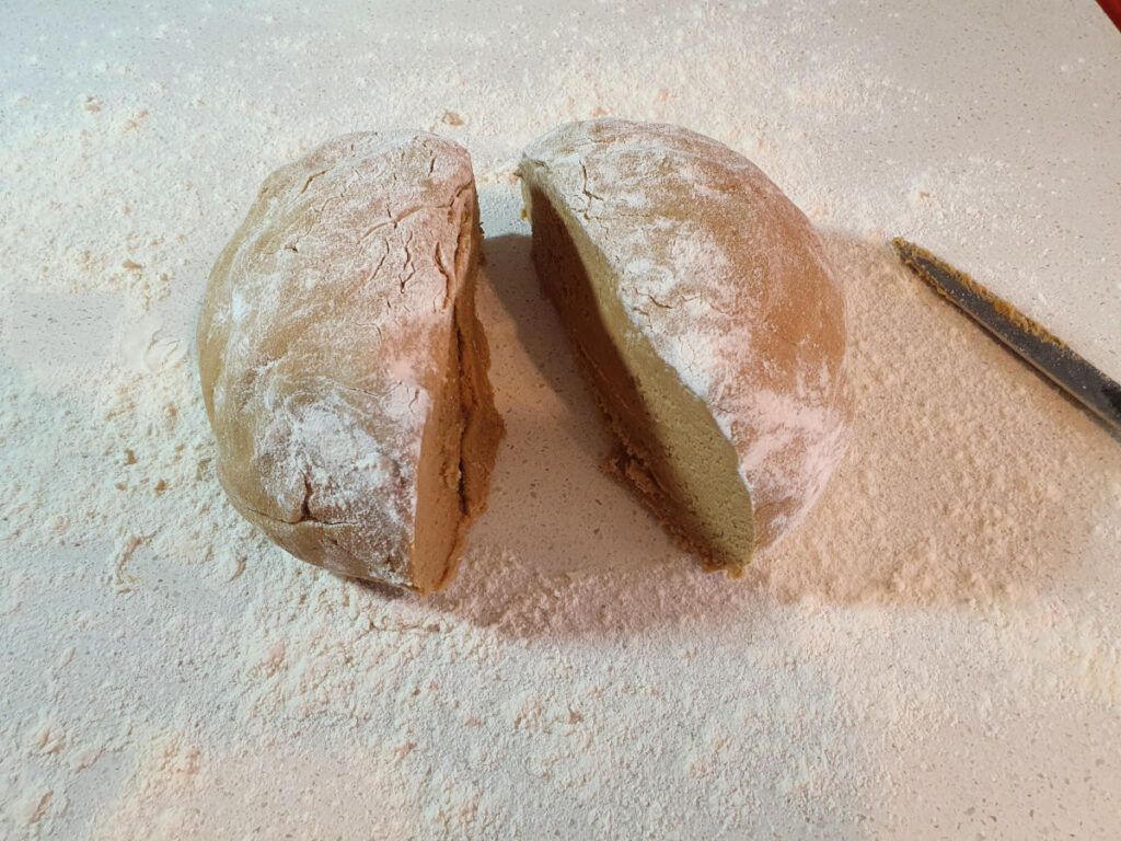 cutting shaped dough in half.