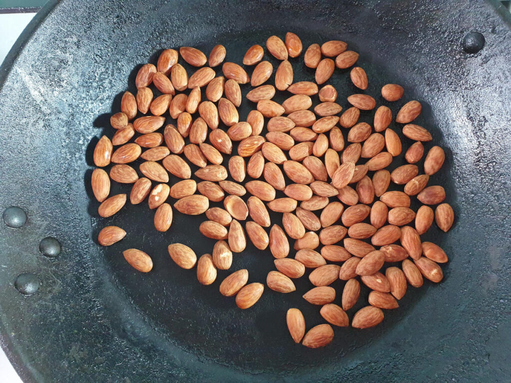 dry roasting almonds in a frying pan.