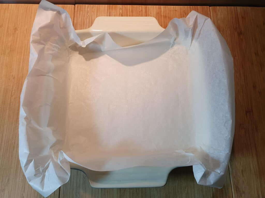 lining baking tray with baking paper.