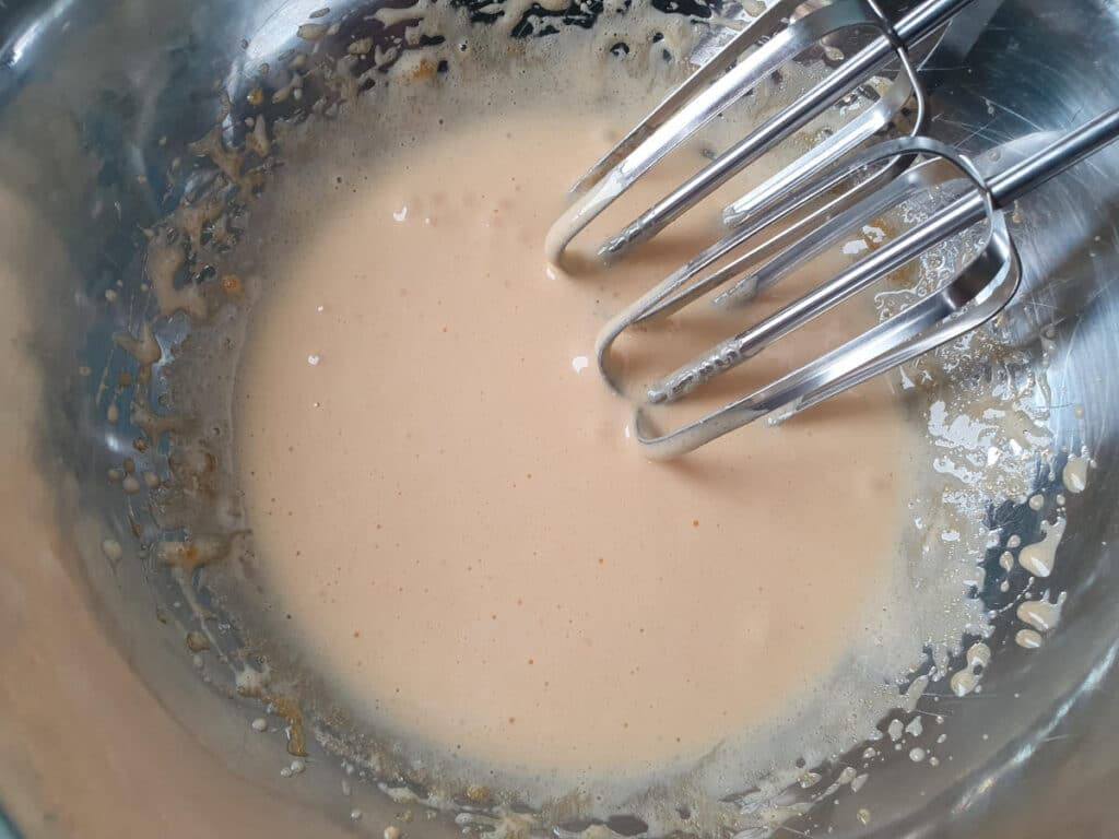 egg yolks and sugar beaten until pale creamy color, ready to start adding warmed milk.