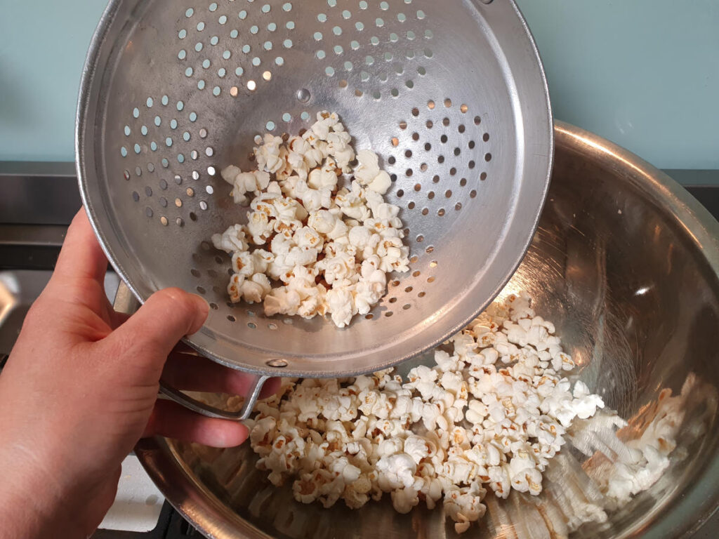 Separating out popped from un popped popcorn.