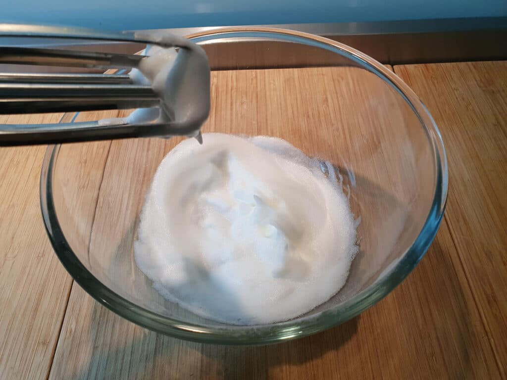 whipping egg white to soft white peaks.