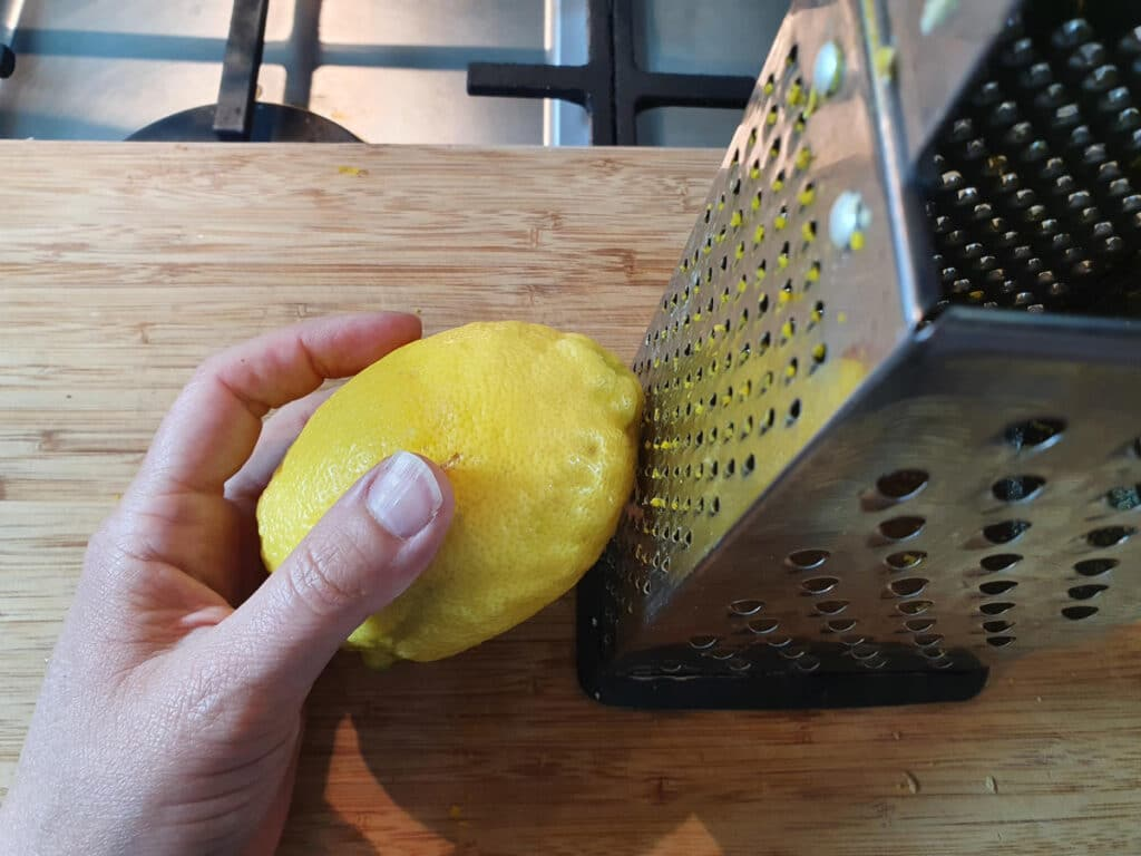 zesting lemon with the fine side of a box grater.
