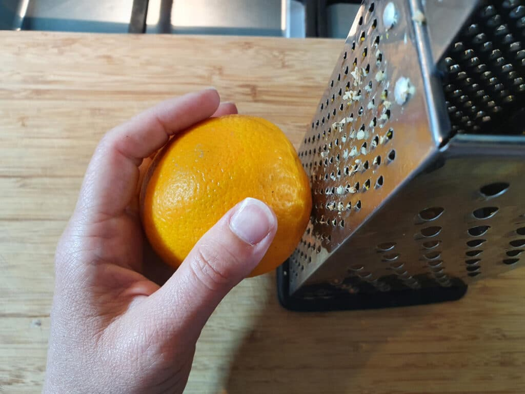 zesting orange with the fine side of a box grater.