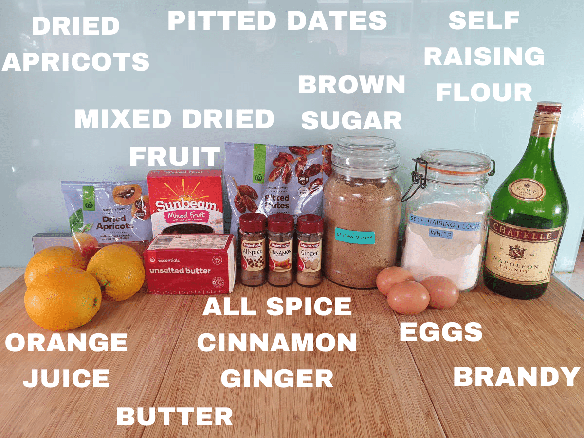 Christmas cake ingredients, dried apricots, mixed dried fruit, pitted dates, brown sugar, self raising flour, orange juice, butter, ground all spice, ground cinnamon, ground ginger, eggs, brandy.