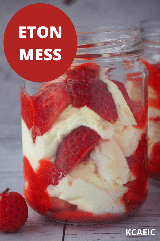 Two jars of Eton mess with fresh strawberries on the side with text overlay, Eton mess, KCAEIC.