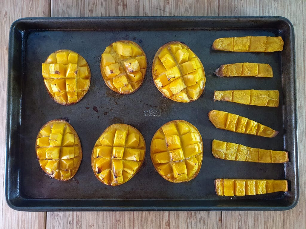 Baked mango on tray.