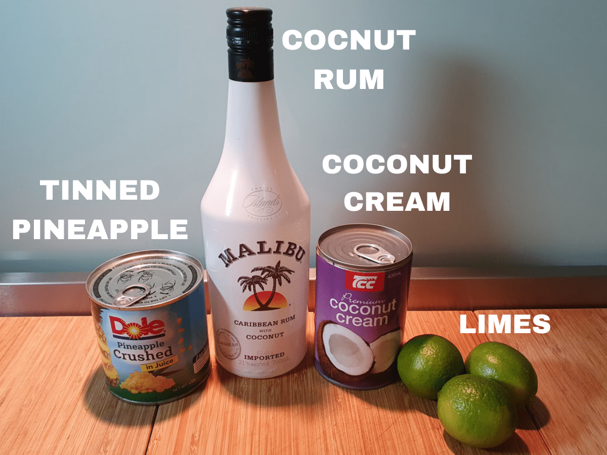 pina colada popsicle ingredients, tinned pineapple, coconut rum, coconut cream and limes.