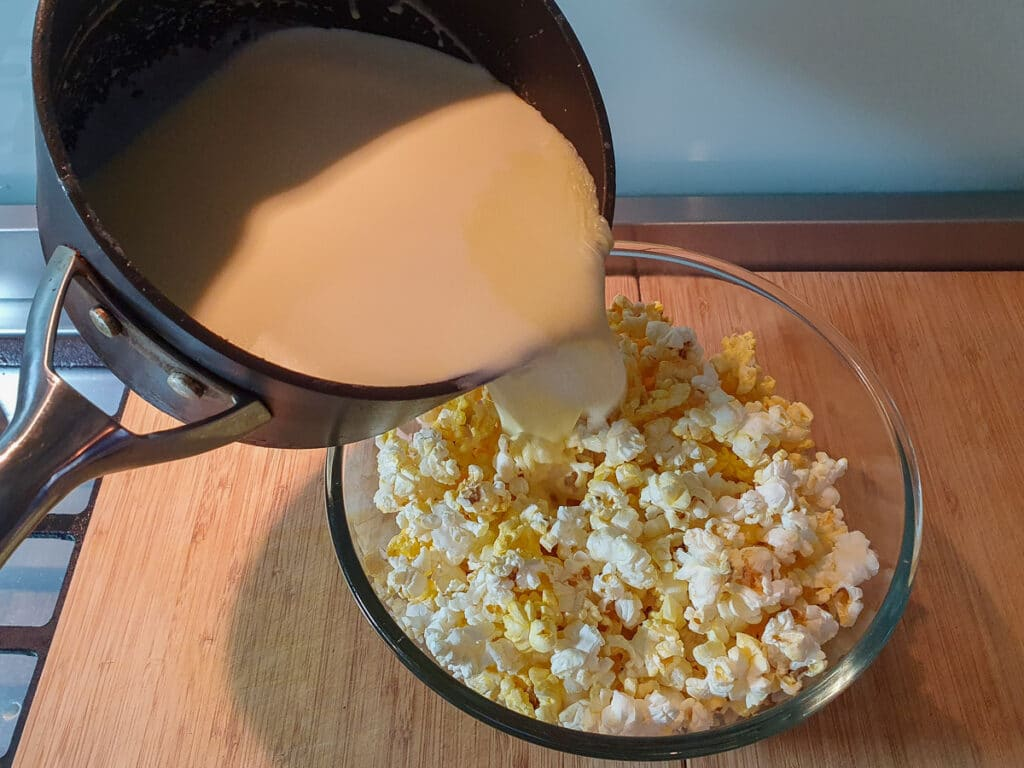 Adding ice cream mix to popcorn.