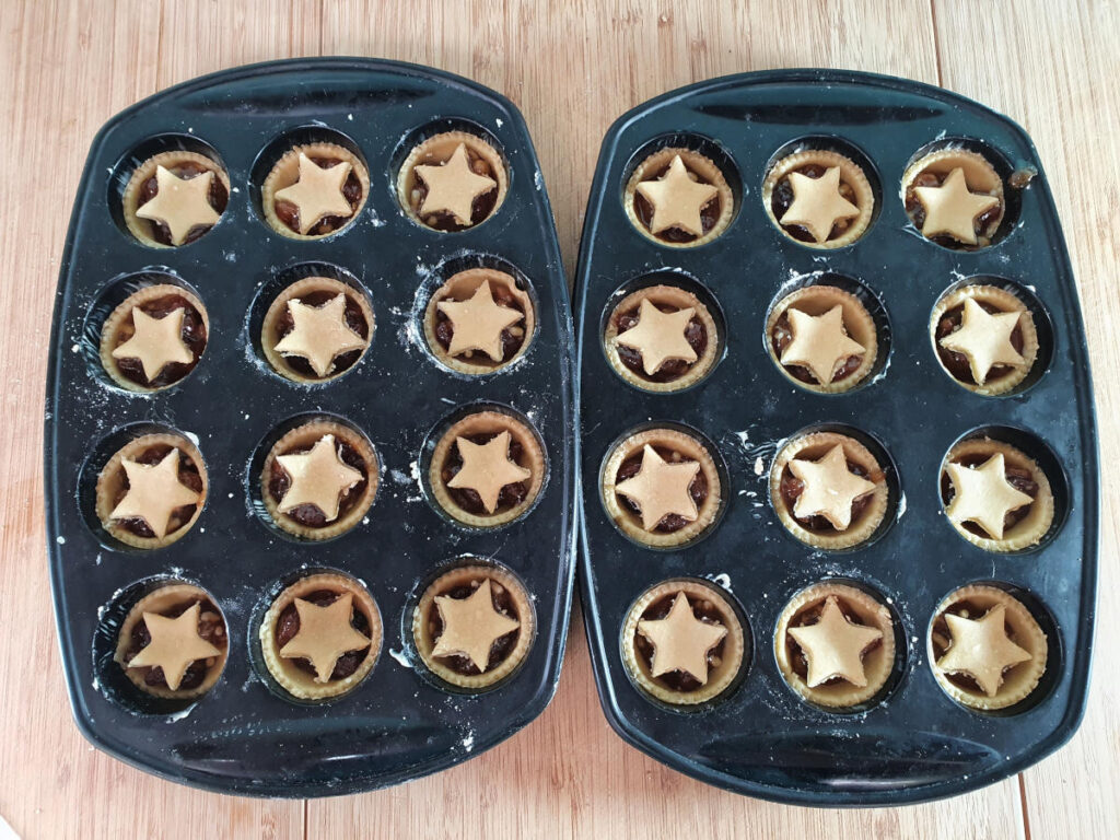 Tarts in mini muffin molds ready to bake.