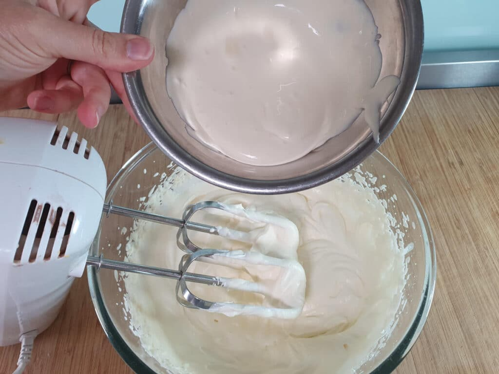 adding sour cream to whipped cream.
