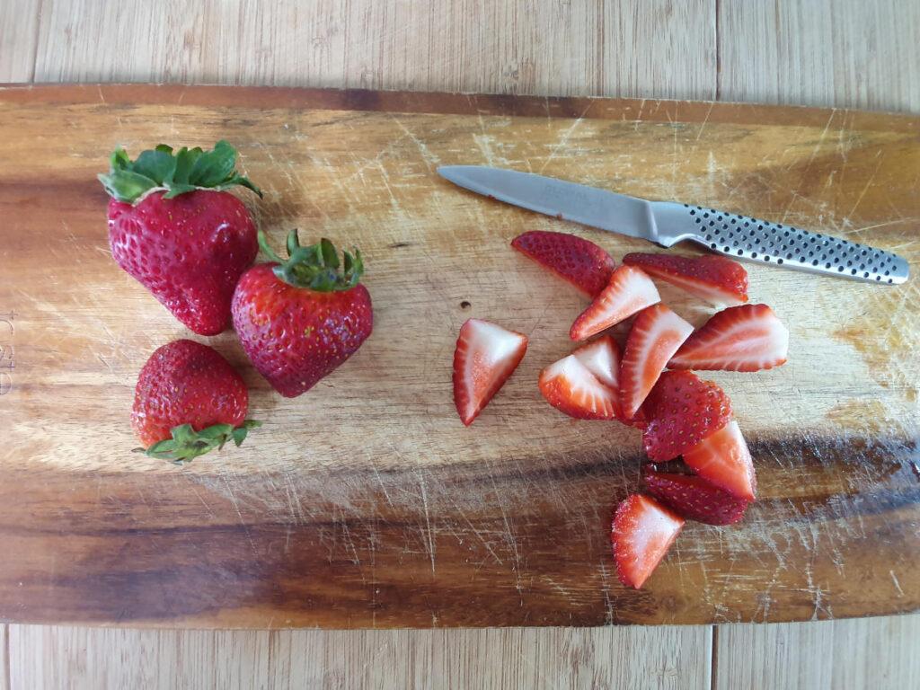 chopping strawberries.