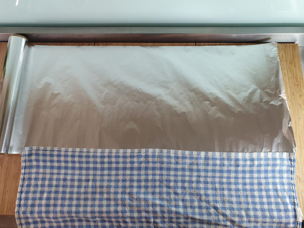 measuring foil against tea towel.