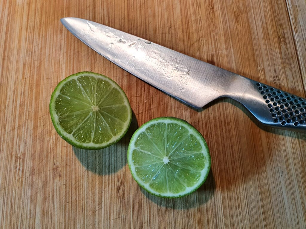 slicing lime ready to juice.
