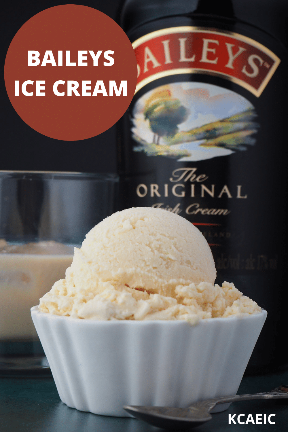 Close up Baileys ice cream scoop with glass of Baileys and bottle of Baileys in the background and text overlay, Baileys ice cream, KCAEIC.